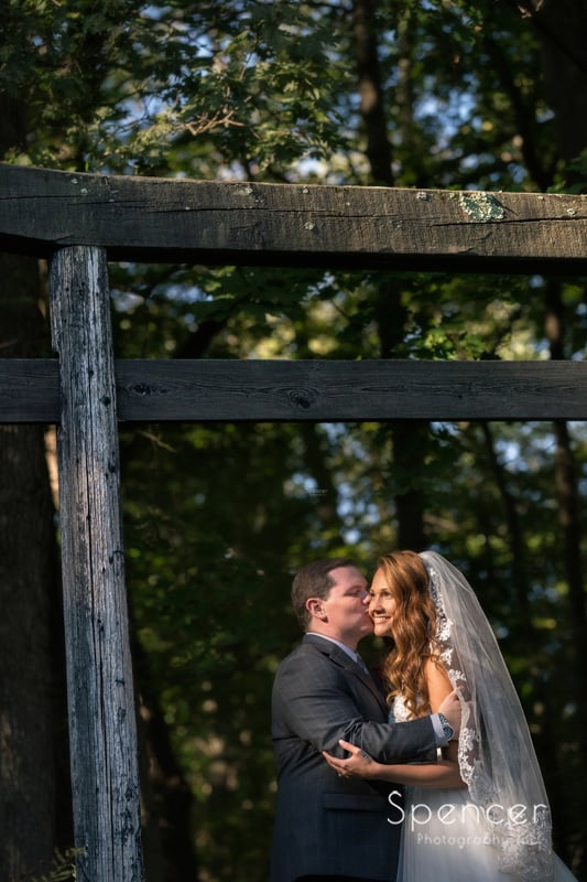 bride and groom hugging in wedding picture at stan hywet