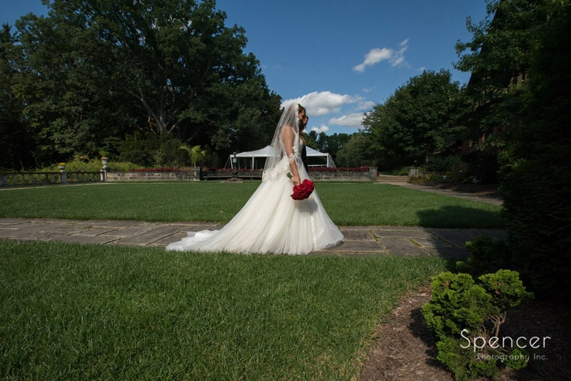 bride and groom leave their wedding ceremony at stan hywet