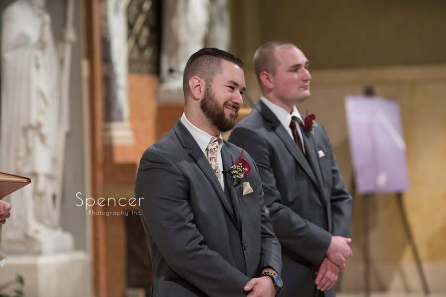 groom watching bride walk aisle at St. Joseph Church