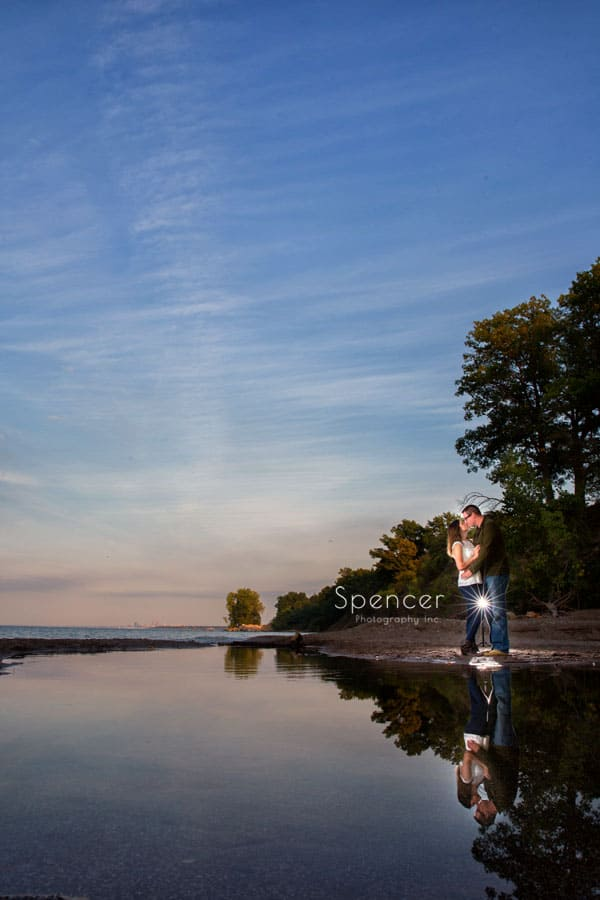 couple in reflection at engagement session on lake erie cleveland