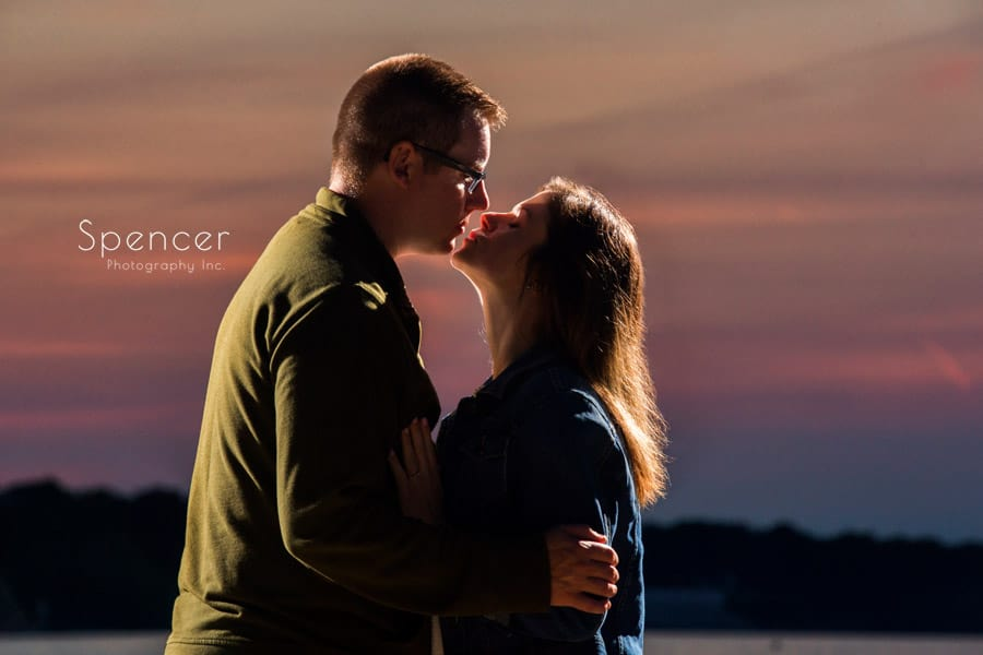 couple kissing at their engagement session on Lake Erie Cleveland