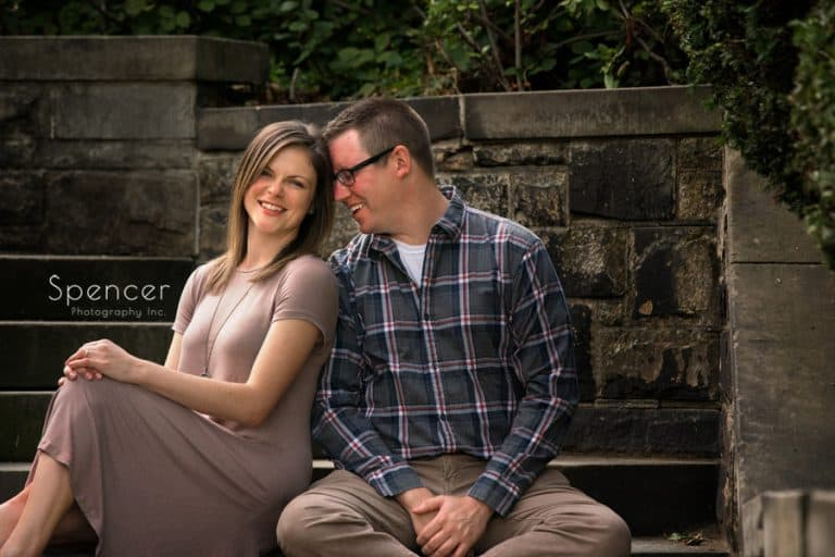 couple laughing in their engagement pictuer at Wade Oval Park