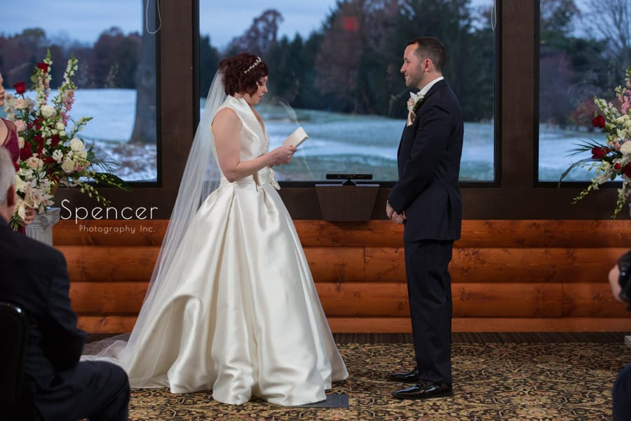 bride reads wedding vows at lodge at firestone