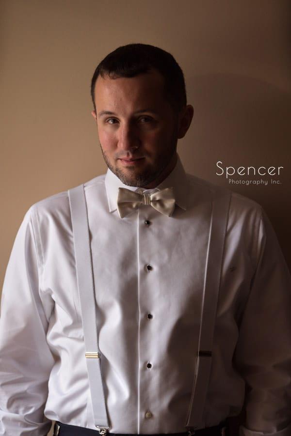 groom portrait in suite at Firestone