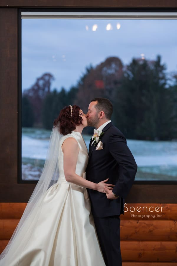 first kiss at wedding ceremony at lodge at firestone