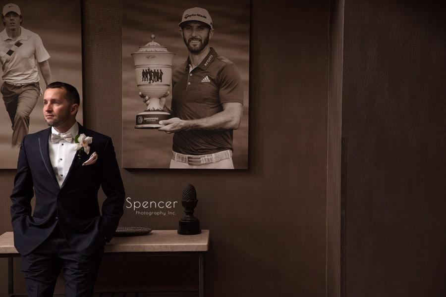 groom posing for wedding picture in Firestone locker room