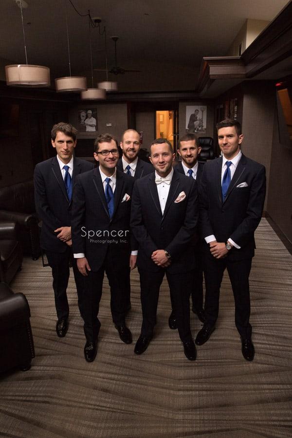 groomsmen posing for wedding picture in Firstone locker room