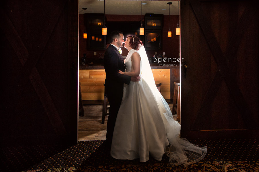 wedding day picture of bride and groom in lodge at firestone