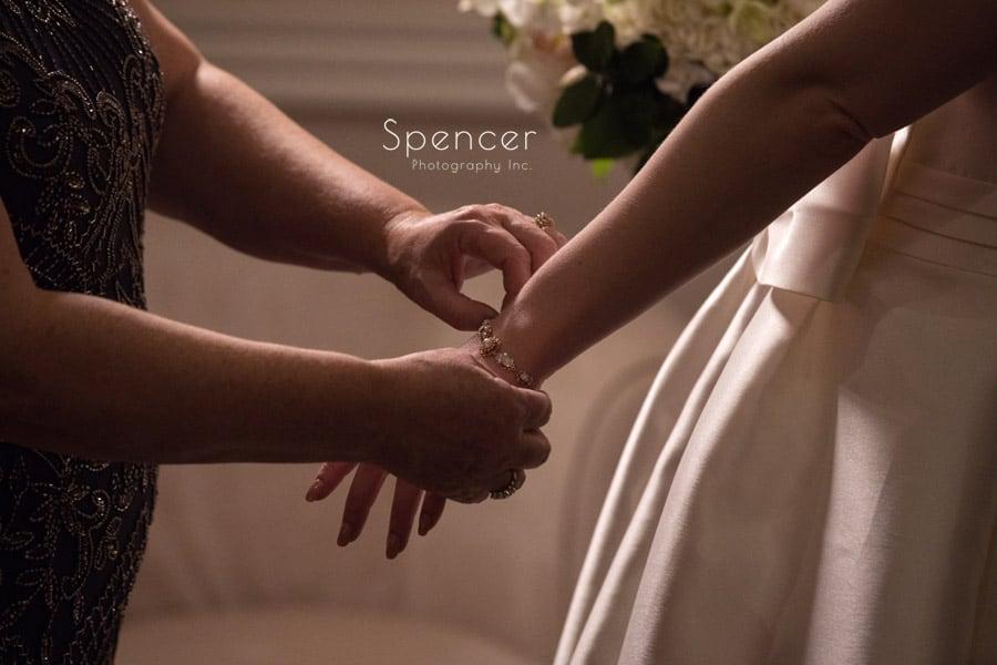 mom helping bride with wedding bracelet at firestone wedding