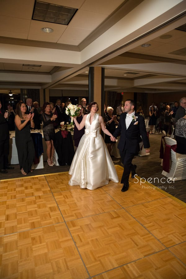 bride and groom enter their reception at firestone