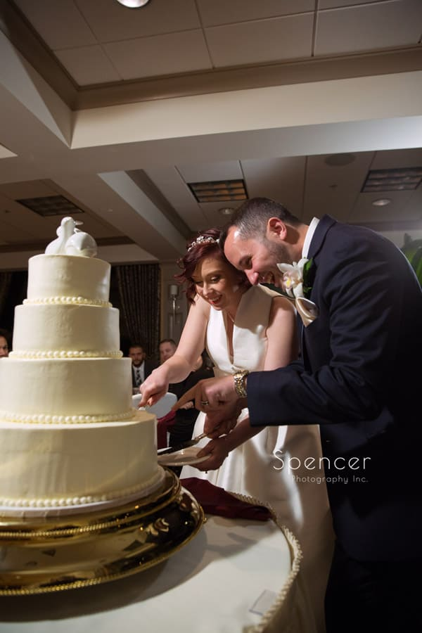 bride and groom cut cake at firestone wedding reception