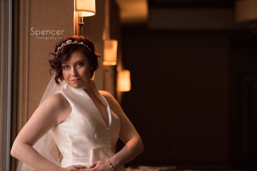bride posing for wedding picture in bar at firestone