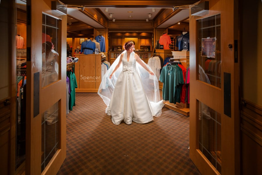 bride in wedding picture in pro shop at firestone
