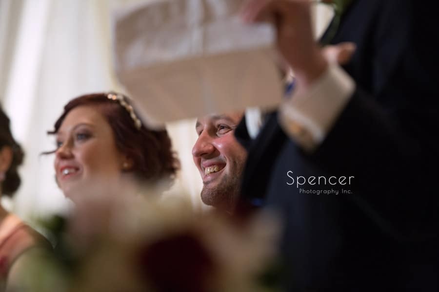 groom smiling during best man speech at firestone reception