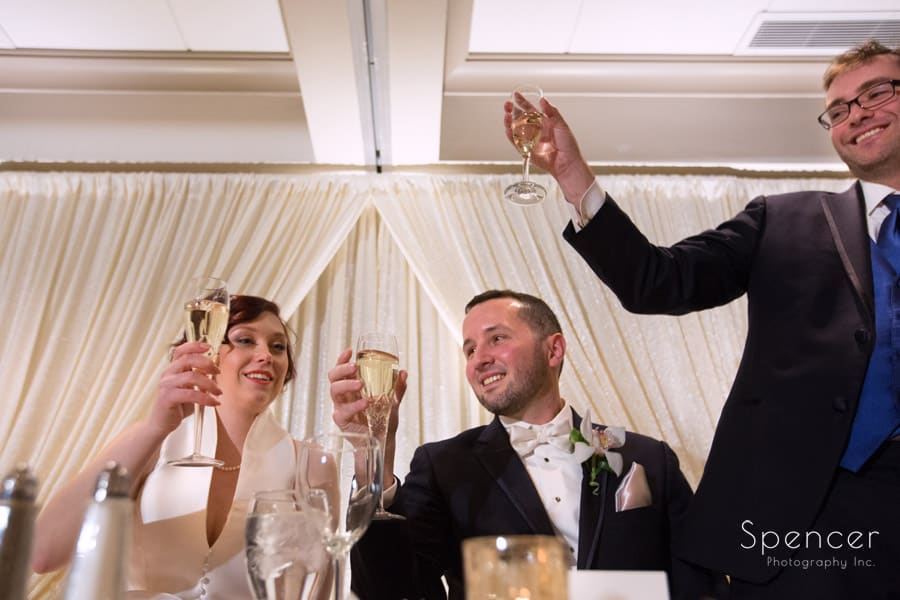 a toast at firestone country club wedding reception