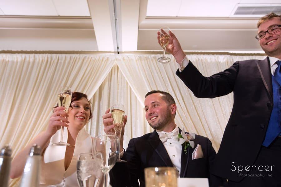 a toast at firestone country club wedding reception
