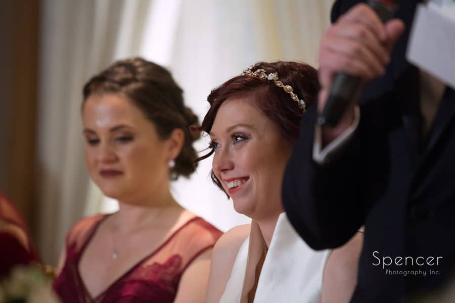 bride smiling at reception table at firestone