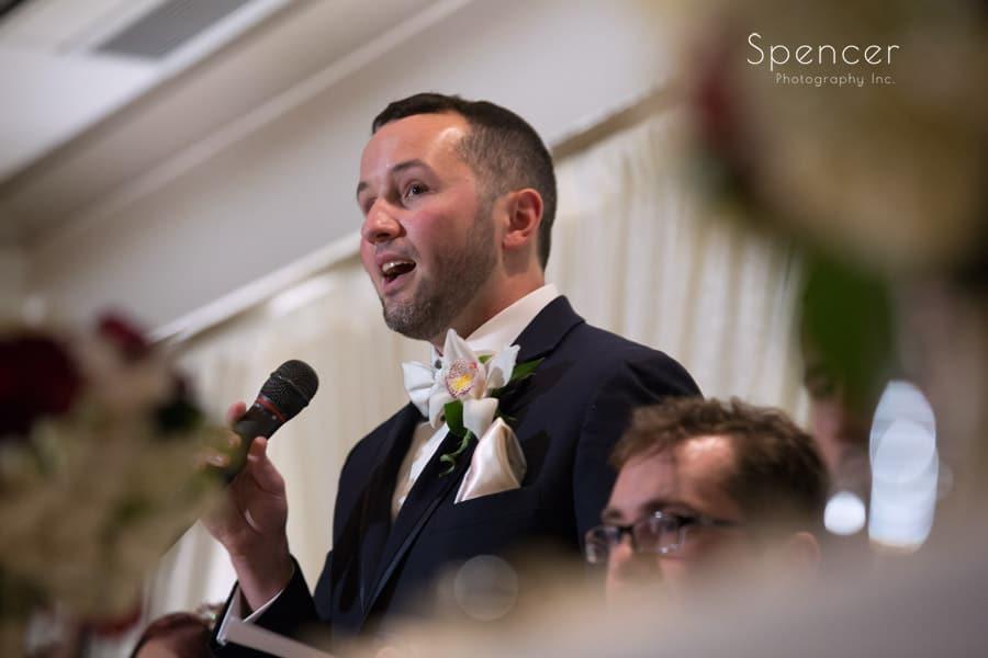 groom giving reception speech at firestone
