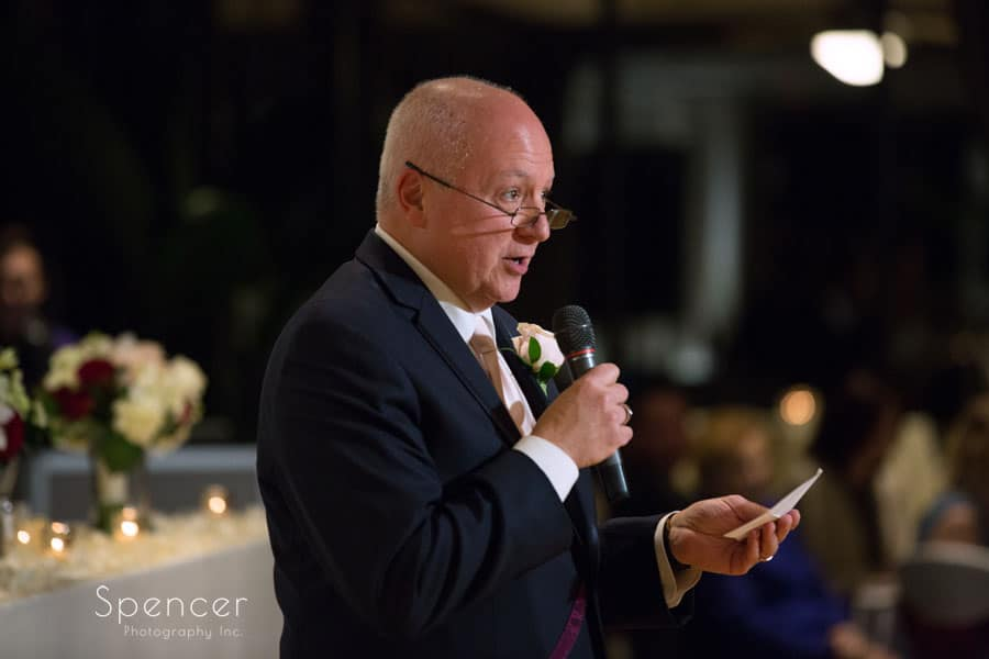 father of groom giving reception prayer