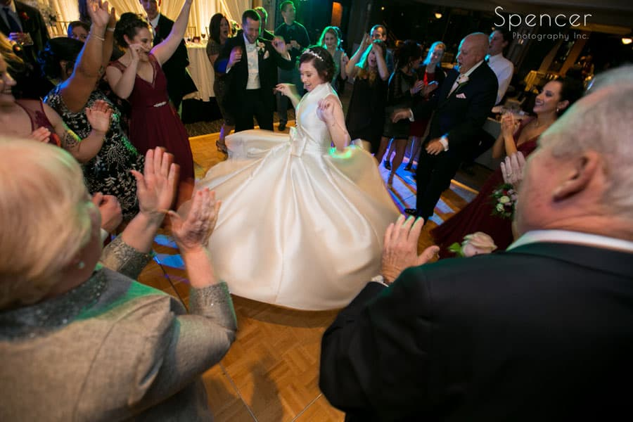 bride twirling in her dress at wedding reception