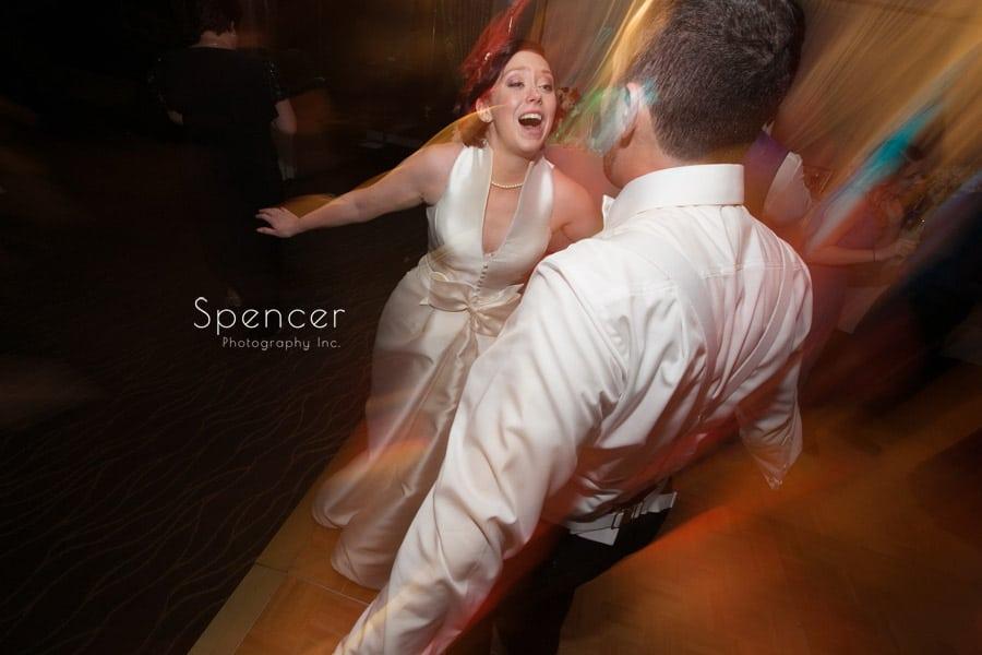 bride singing to groom at wedding reception