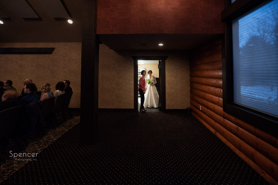 bride preparing to walk at her wedding ceremony at Firestone Lodge