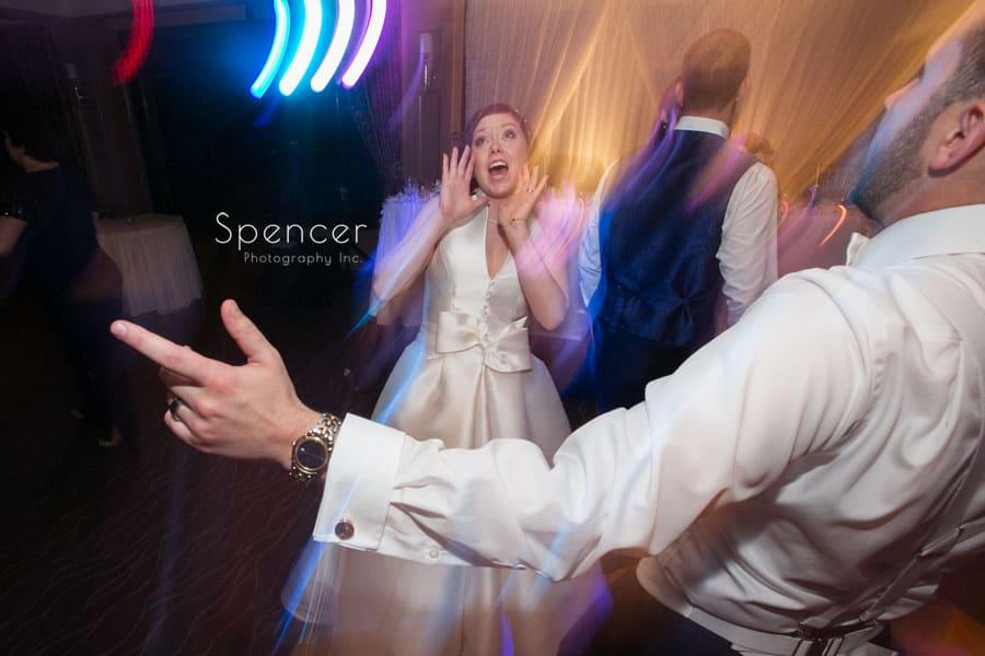 bride singing at her wedding reception