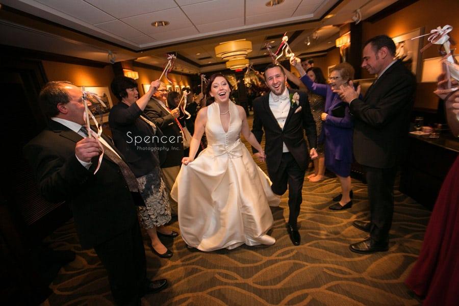 bride and groom exit wedding reception at firestone