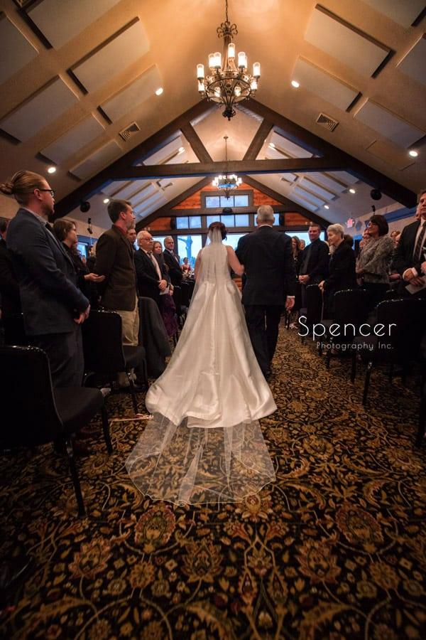 dad walking bride down aisle at wedding at Firestone Lodge