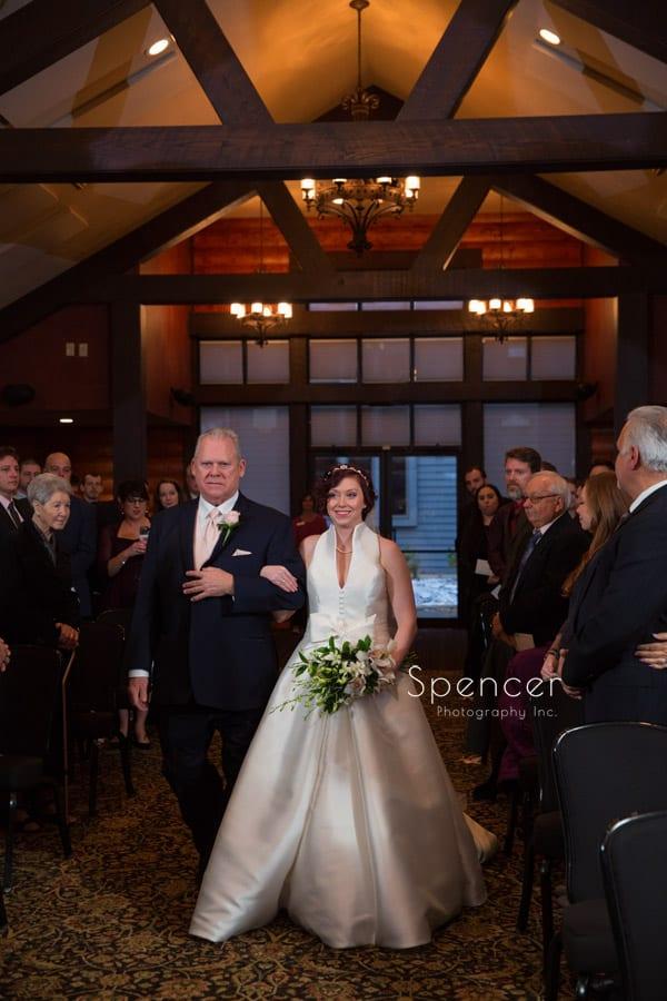 dad and bride walking at Firestone Lodge wedding ceremony