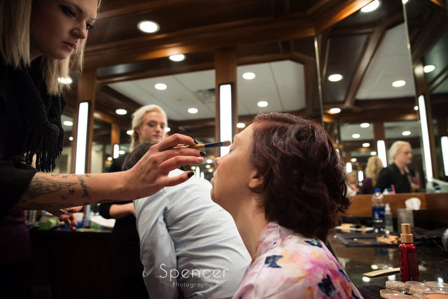 a simple picture of bride getting make up