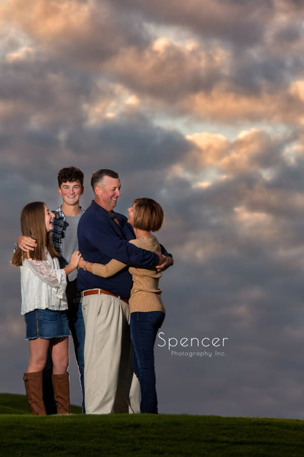 family hugging during fall family pictures in cleveland