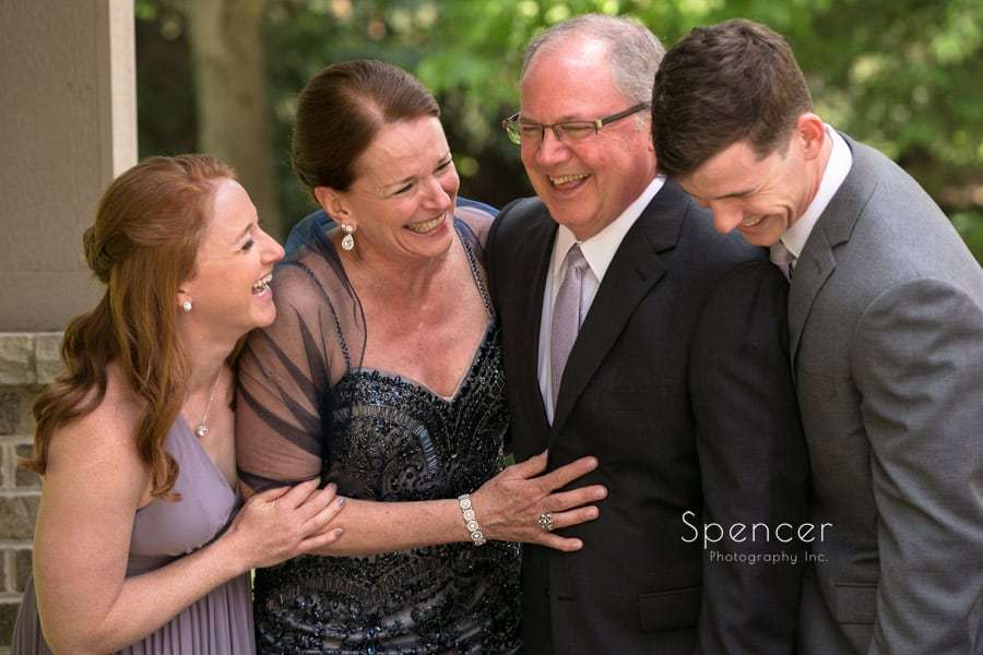family laughing in picture at cleveland wedding