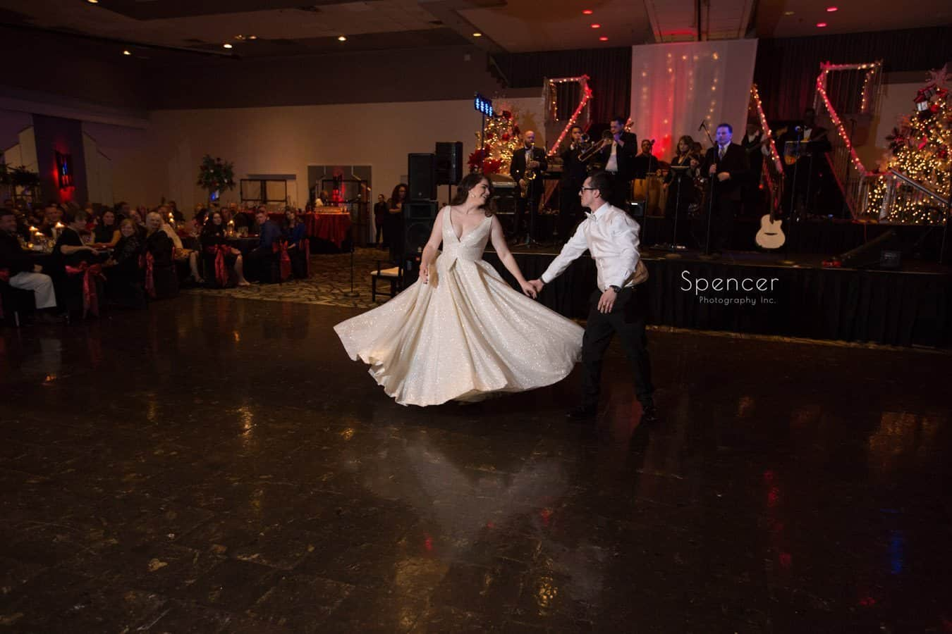 groom spins bride during first dance at wedding reception at landerhaven