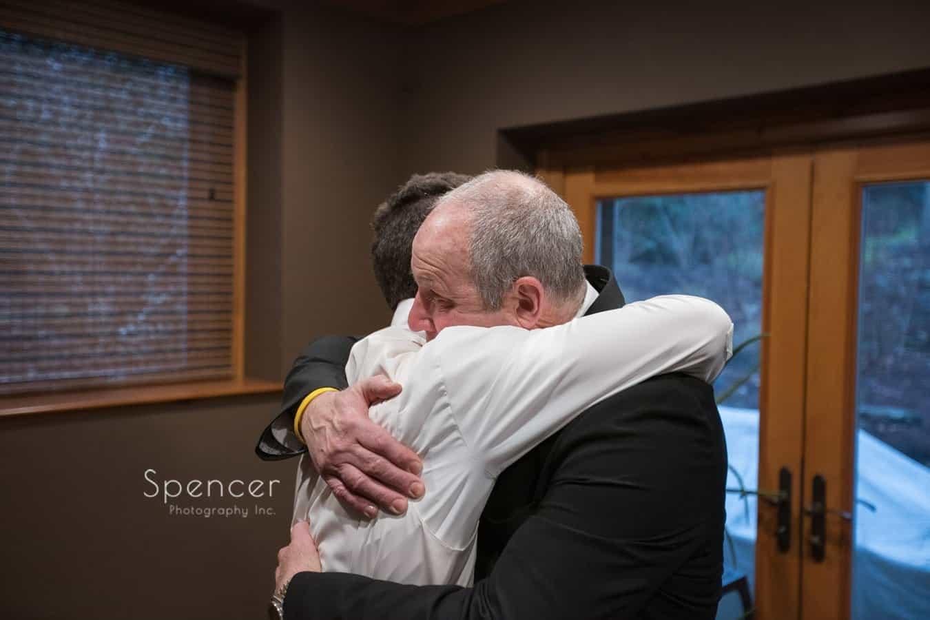 grooms dad hugging groom