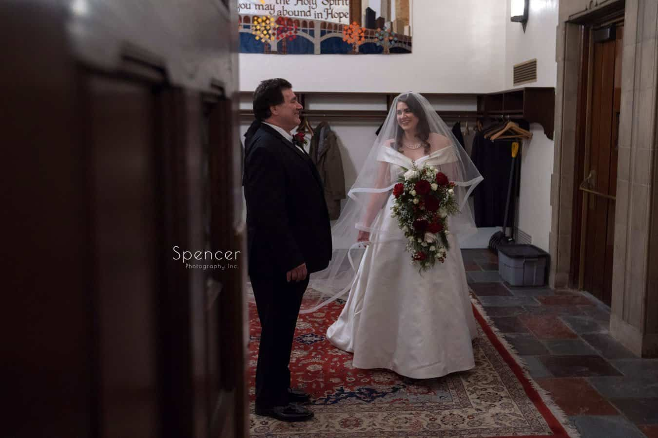 bride and father share a moment before wedding at first baptist church