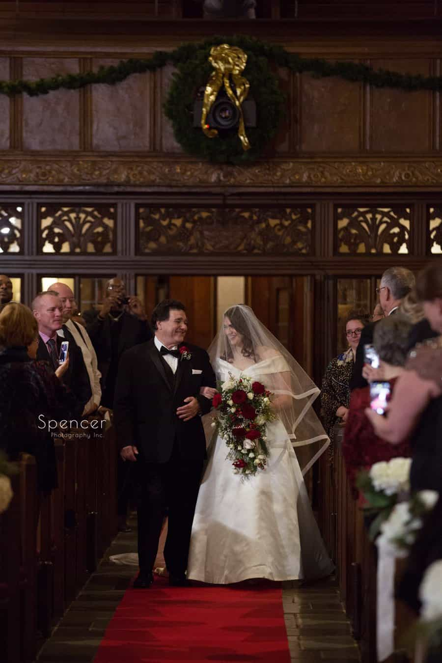 dad walks bride down aisle at first baptist christmas wedding