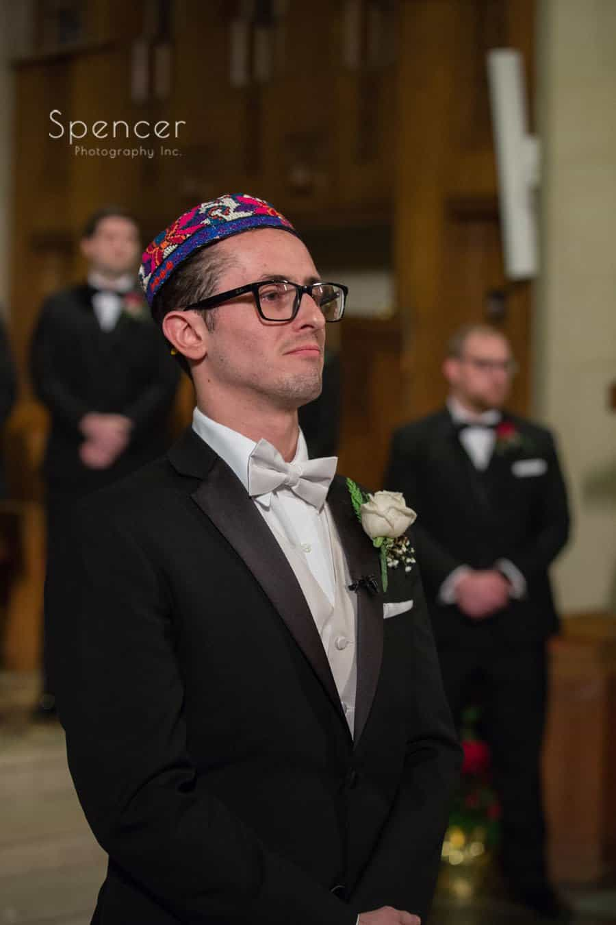 groom watching bride walk down aisle at first baptist