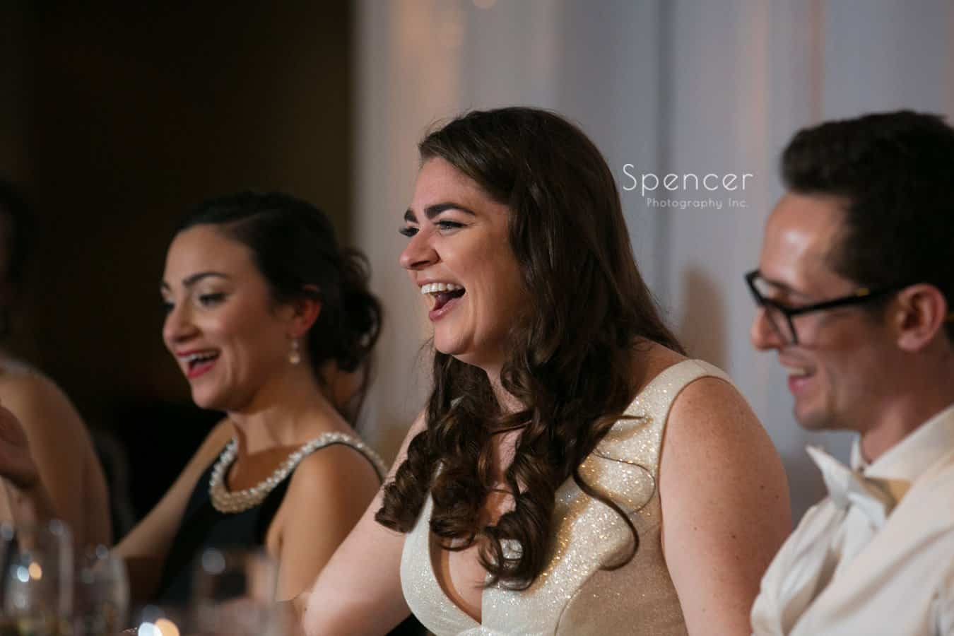 bride laughing during reception speech at landerhaven