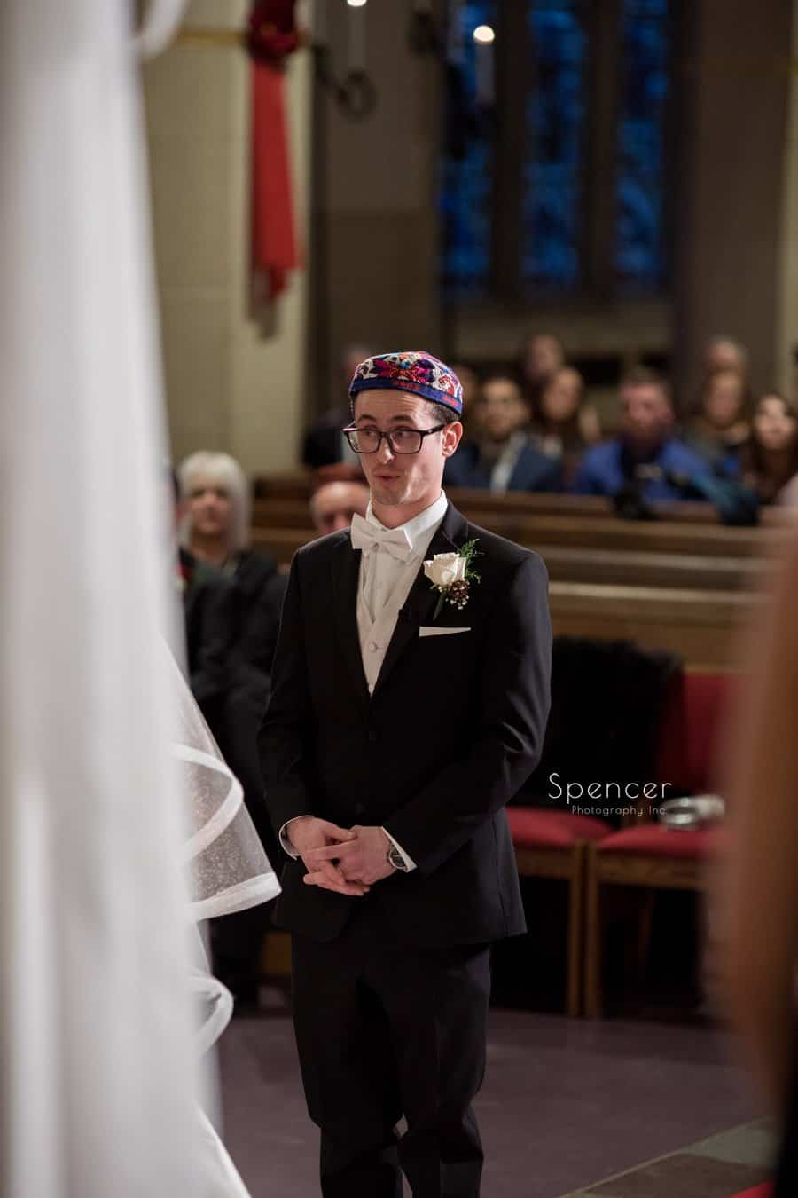 groom talking during wedding ceremony at first baptist in cleveland