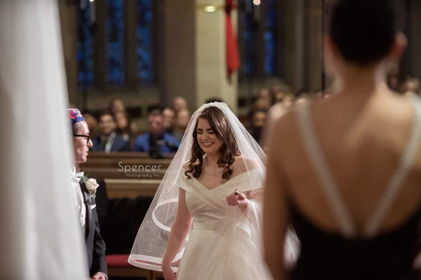 bride laughing during christmas wedding at first baptist church cleveland