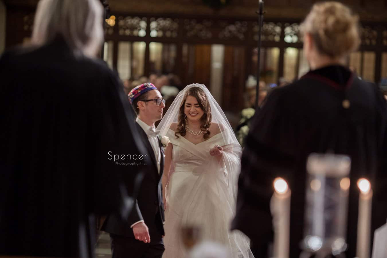 bride giggling during christmas wedding at first baptist cleveland
