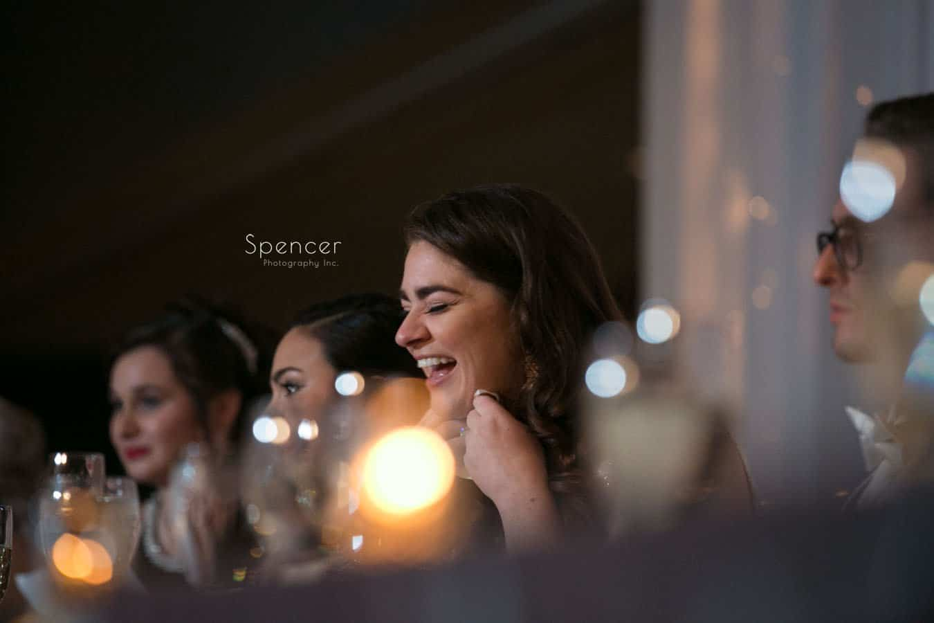 bride laughing during fathers reception speech at landerhaven
