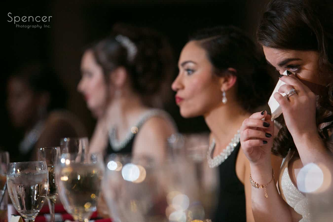 bride wiping tear away after wedding speech at landerhaven reception