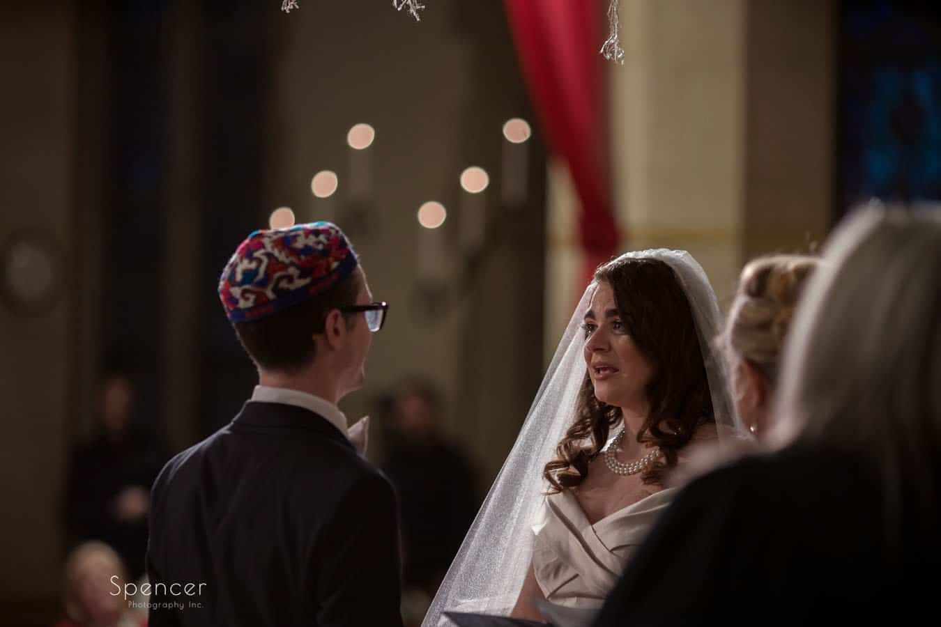 bride talking to groom during wedding at first baptist church cleveland