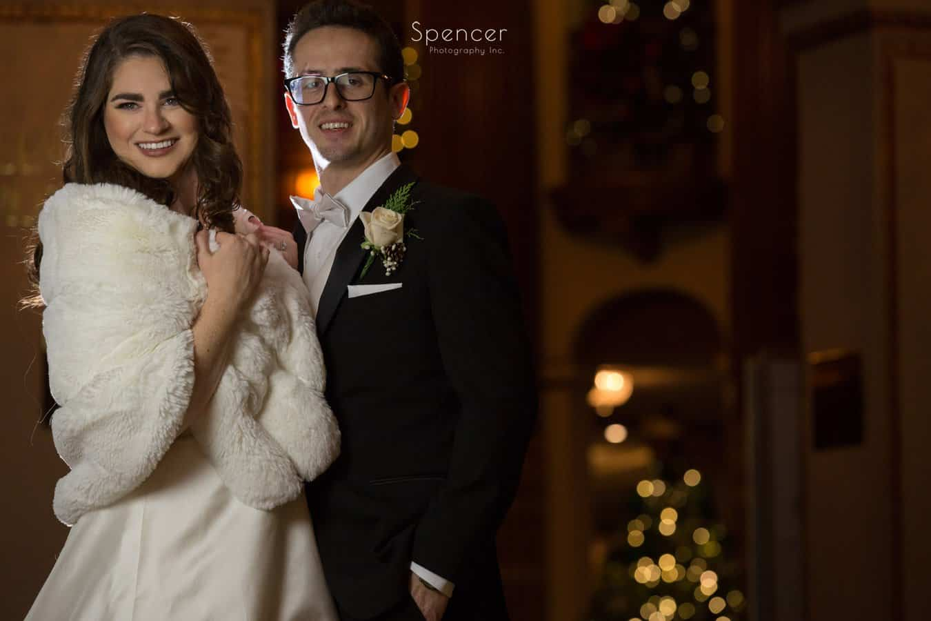 bride and groom smiling into camera at playhouse square wedding photo shoot