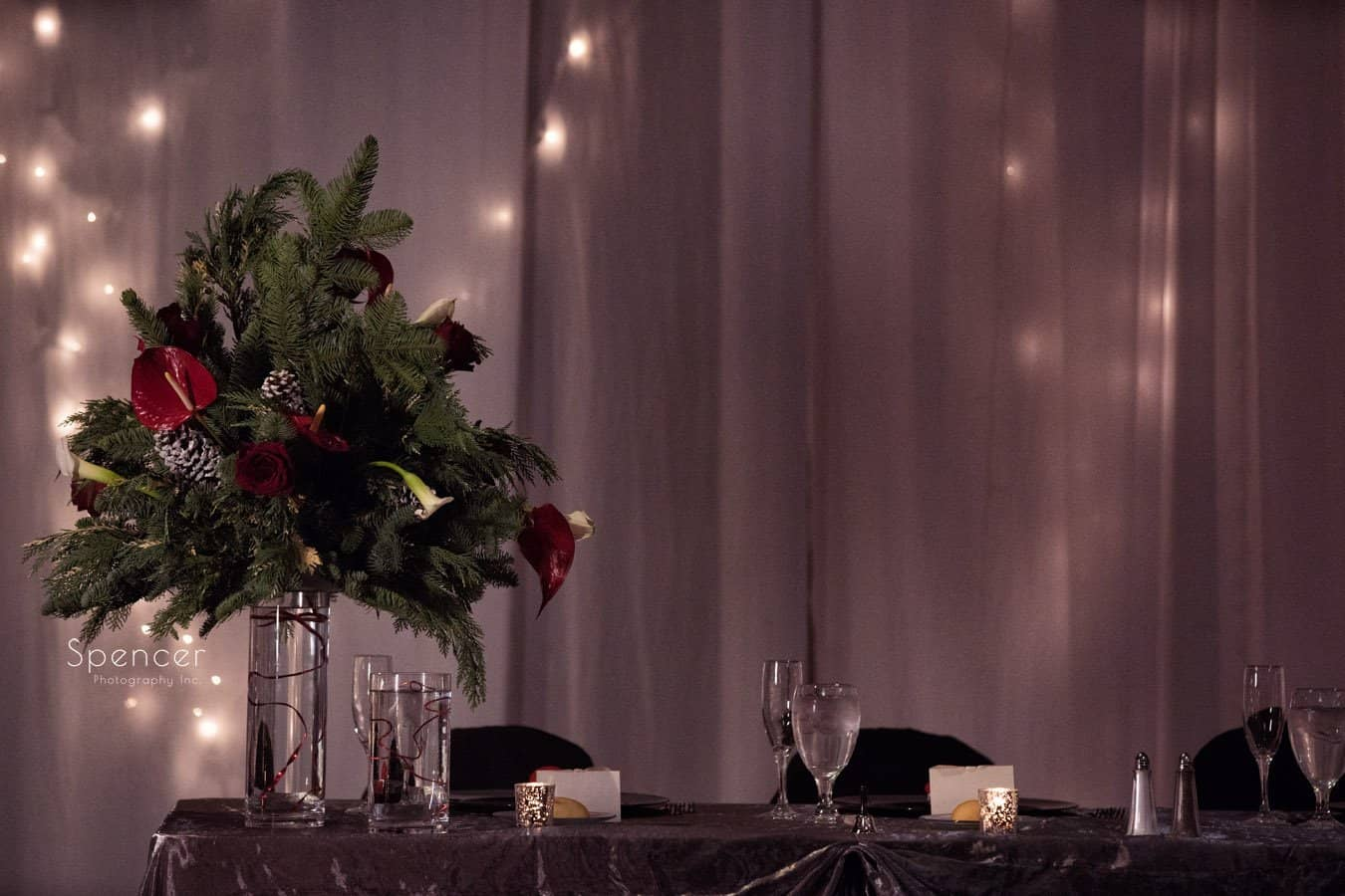 head table floral arrangement at christmastime wedding reception at landerhaven