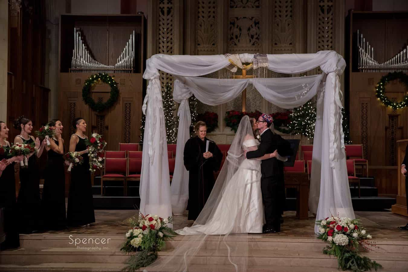 first kiss at christmas wedding at first baptist church