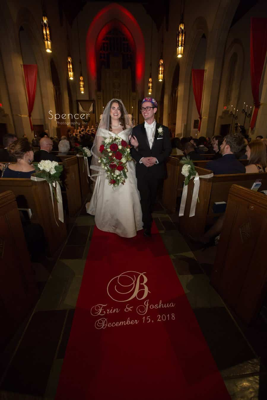 bride and groom walk thr recessional at first baptist church