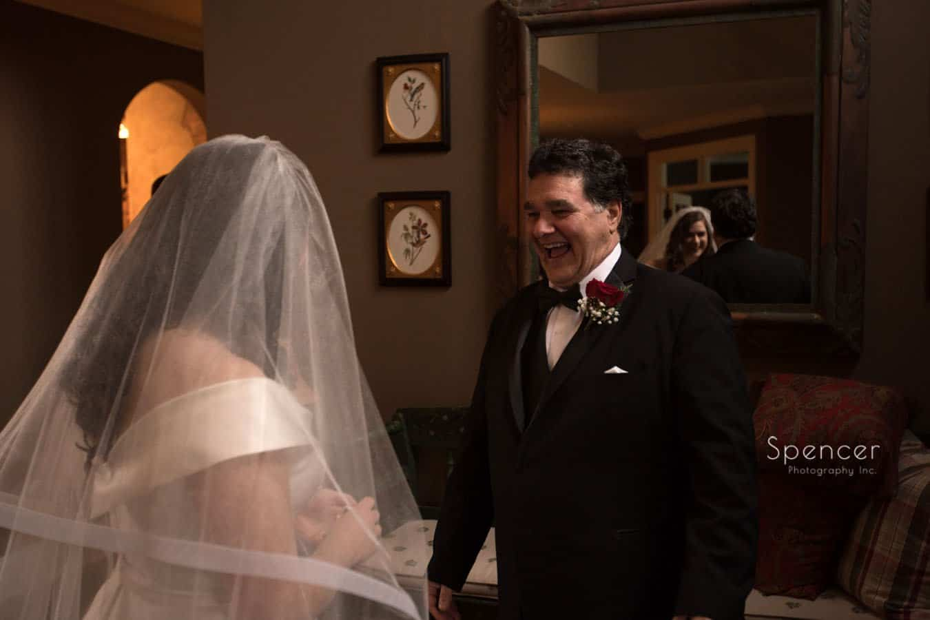 dad laughing with bride